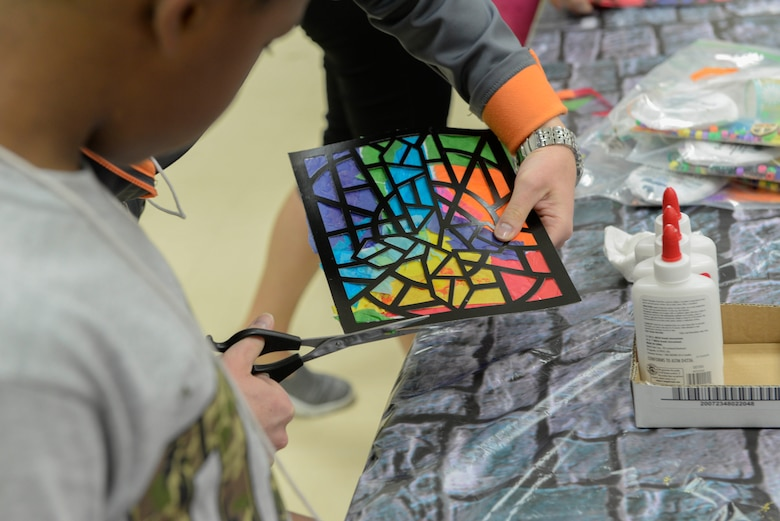 Participants of Yokota's annual Vacation Bible School create stained glass windows at Yokota Air Base, Japan, June 23, 2017. A different story from the Bible served as the theme for the activities each day.