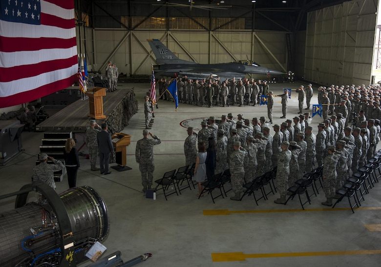 U.S. Air Force Col. David Shoemaker, 8th Fighter Wing commander, Col. James Long, 8th Maintenance Group outgoing commander, and Col. George Sebren, 8th MXG incoming commander, salute June 28, 2017, during a change of command ceremony at Kunsan Air Base, Republic of Korea. During the ceremony, Long relinquished command of the 8th MXG to Sebren. (U.S. Air Force photo by Senior Airman Colville McFee/Released)