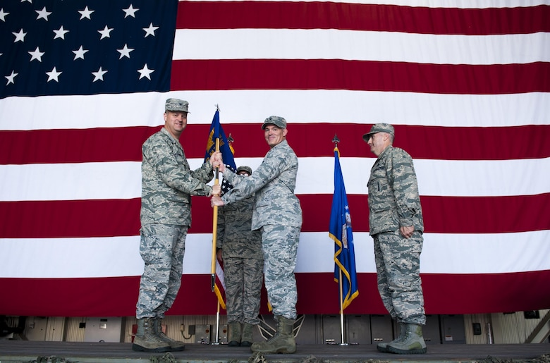 U.S. Air Force Col. George Sebren, 8th Maintenance Group commander, receives the guidon from Col. David Shoemaker, 8th Fighter Wing commander, during a change of command ceremony held June 28, 2017, at Kunsan Air Base, Republic of Korea. Shoemaker presided over the ceremony in which Col. James Long relinquished command of the 8th MXG to Sebren. (U.S. Air Force photo by Senior Airman Colville McFee/Released)