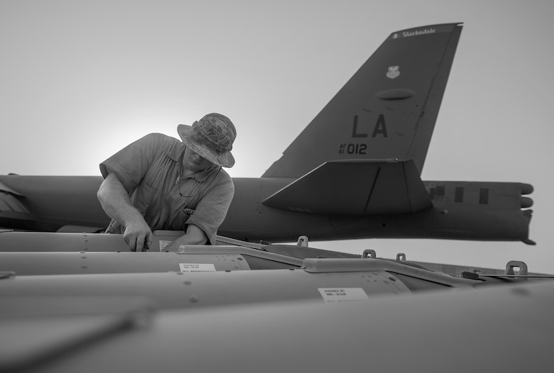 A munitions technician, assigned to the 23rd Expeditionary Aircraft Maintenance Unit, prepares to load munitions on a B-52 Stratofortress assigned to the 23rd Expeditionary Bomb Squadron at an undisclosed location in Southwest Asia, June 15, 2017. The 23rd EAMU provided the 400th consecutive sortie without a maintenance cancellation on the day the 23rd EBS celebrated the 100th anniversary of the unit. (U.S. Air Force photo by Staff Sgt. Trevor T. McBride)