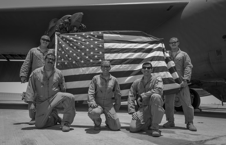 B-52 Stratofortress aircrew, assigned to the 23rd Expeditionary Bomb Squadron, pose for a photo after returning from a flight at an undisclosed location in Southwest Asia, June 16, 2017. The flight was the 400th consecutive sortie without a maintenance cancellation on the day the unit celebrated its 100th anniversary. (U.S. Air Force photo by Staff Sgt. Trevor T. McBride)