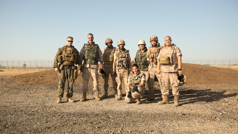 Warrant Officer Dan Pare, left, explosive ordnance disposal officer for Special Purpose Marine Air-Ground Task Force-Crisis Response-Africa, stands with EOD personnel of the Spanish Second Air Support Deployment Squadron (SEADA) after the successful completion of a joint explosive demolition training at Morón Air Base, Spain, June 20, 2017. This was the first time, either jointly or separately, U.S. and Spanish EOD personnel conducted live, explosive ordnance training on the air base. (U. S. Marine Corps photo by Staff Sgt. Kenneth K. Trotter Jr./Released)