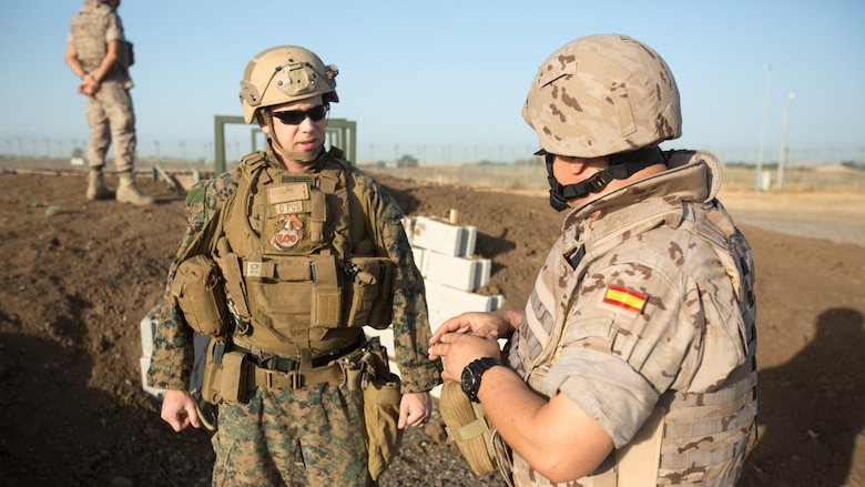 Warrant Officer Dan Pare, the explosive ordnance disposal officer for Special Purpose Marine Air-Ground Task Force-Crisis Response-Africa, speaks with Sub-officer Major Benito Florido Cauovas, the EOD sub-officer major for the Spanish Second Air Support Deployment Squadron (SEADA), during preparation for a live-fire explosive training at Morón Air Base, Spain, June 20, 2017. This was the first time, either jointly or separately, U.S. and Spanish EOD personnel conducted live, explosive ordnance training on the air base. (U. S. Marine Corps photo by Staff Sgt. Kenneth K. Trotter Jr./Released)