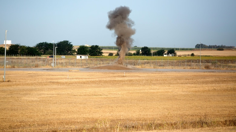 Dynamite explodes during live-fire demolition training between explosive ordnance disposal personnel of Special Purpose Marine Air-Ground Task Force-Crisis Response-Africa and Spanish Second Air Support Deployment Squadron (SEADA) at Morón Air Base, Spain, June 20, 2017. This was the first time, either jointly or separately, U.S. and Spanish EOD personnel conducted live, explosive ordnance training on the air base. (U. S. Marine Corps photo by Staff Sgt. Kenneth K. Trotter Jr./Released)