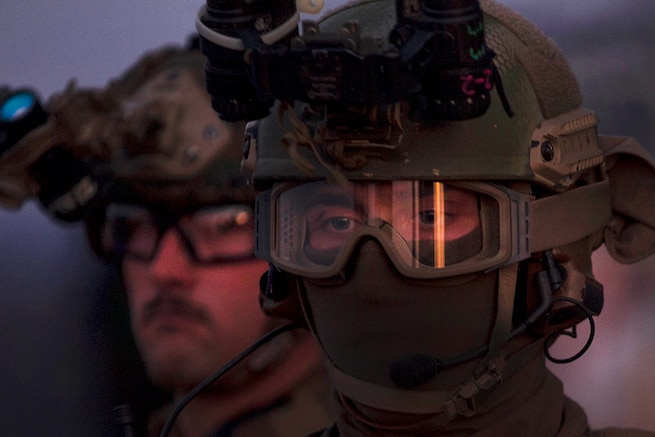 Marines wait during fast-rope training in low light aboard the USS Bonhomme Richard in the Pacific Ocean, June 25, 2017. The Marines are assigned to 31st Marine Expeditionary Unit's Force Reconnaissance Platoon. The Marines train regularly for quick, tactical raids on both land and sea, allowing them to enter otherwise inaccessible locations using a rope from a hovering aircraft. Marine Corps photo by Staff Sgt. T. T. Parish