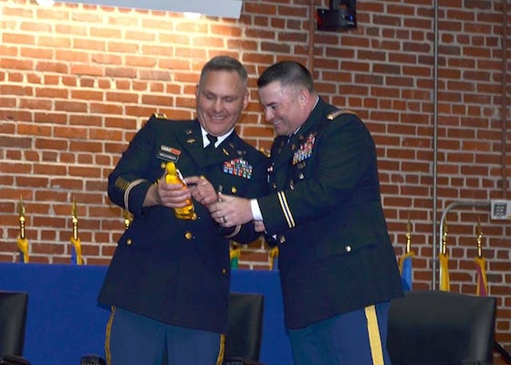 Army Col. Mark Hirschinger, left, and Army Chief Warrant Officer 4 Kevin Ryan share a laugh over a shampoo bottle guaranteeing 'no more tears' prior to their joint retirement ceremony held June 22, 2017 on Defense Supply Center Richmond, Virginia.  Hirschinger and Ryan have served a combined 52 years of service, closing out their careers in the Customer Operations Directorate of Defense Logistics Agency Aviation.