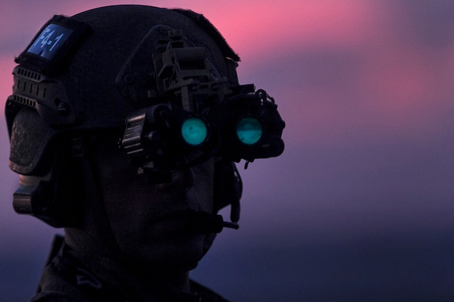 A Marine wearing night vision goggles waits on the flight deck before participating fast-rope training during low light aboard the USS Bonhomme Richard in the Pacific Ocean, June 25, 2017. Marine Corps photo by Staff Sgt. T. T. Parish