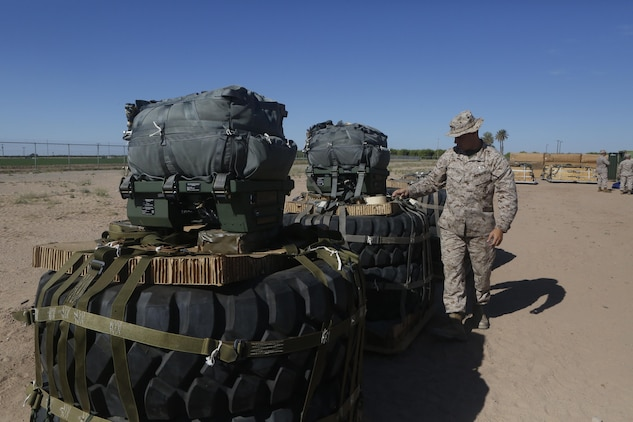 U.S Marine Pfc. Brad A. Clark inspects the rigged aerial delivery systems of Joint Precision Airdrop Systems during a Weapons and Training Instructor Course March 30, 2017, at Marine Corps Air Station Yuma, Ariz. The JPADS systems use GPS, a modular autonomous guidance unit, or MAGU, a parachute and electric motors to guide cargo within 150 meters of their target points. Marine Corps Systems Command fielded the last of 162 JPADS to the fleet in April, turning the page from acquisition to sustainment of the system for the Corps. (U.S. Marine Corps photo by Lance Cpl. Jocelyn Ontiveros)