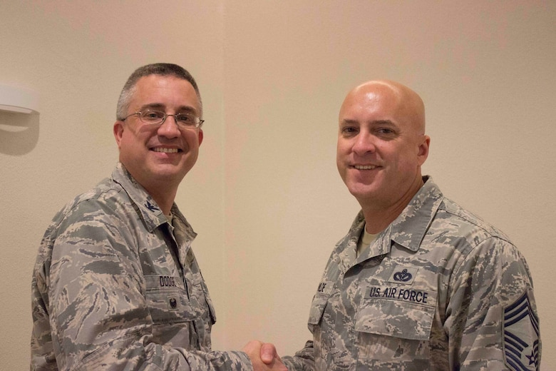 Col. Timothy Dodge, director of AFCEC's Operations Directorate, and Chief John Wilde, civil engineer chief of enlisted matters, pose for the camera during the recent Education Training and Review Committee meeting at Ramstein Air Base, Germany. Wilde coined the colonel for his advocacy and outstanding support of enlisted Airmen worldwide over the past three years. (U.S. Air Force photo/Susan Lawson)