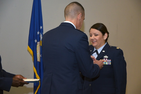 U.S. Air Force Maj. Shelby Henry, 17th Logistics Readiness Squadron Commander, receives the meritorious service medal from Col. Jason Beck, 17th Mission Support Group Commander, at the Event Center on Goodfellow Air Force Base, Texas, June 27, 2017. The Meritorious Service Medal may be awarded to any member of the armed forces of the United States who distinguishes themselves by either outstanding achievement or meritorious service. (U.S. Air Force photo by Airman 1st Class Randall Moose/Released)