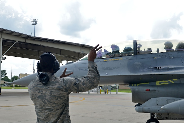 A U.S. Airman marshals out Col. Douglas Thies, 20th Operations Group commander, and Col. David Vaclavik, 20th Mission Support Group commander, in an F-16D Fighting Falcon at Shaw Air Force Base, S.C., May 30, 2017. Shaw marked the first assignment Thies and Vaclavik have had together since they graduated from the Texas A&M University Cadet Corps. (U.S. Air Force photo by Airman 1st Class Destinee Sweeney)
