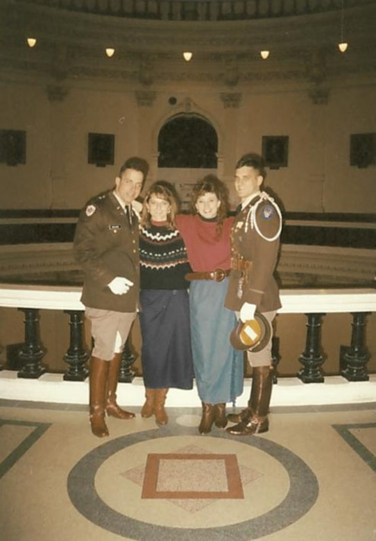 Texas A&M University cadets Douglas Thies, far right, and David Vaclavik, far left stand for a picture in their uniforms with their future wives after a Texas A&M football game in Austin, Texas, circa 1992. As best friends, the two would become commissioned Air Force officers and eventually command groups at Shaw Air Force Base, S.C., at the same time. (Courtesy photo)