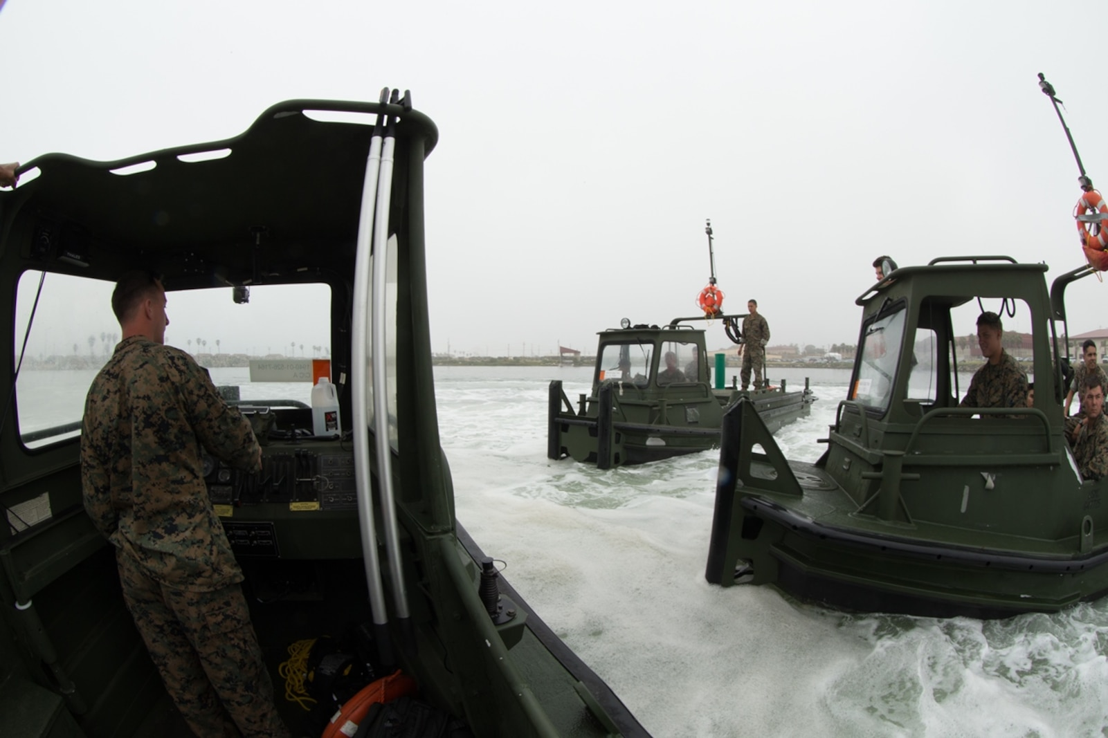 U.S. Marines with Bridge Company, 7th Engineer Support Battalion, 1st Marine Logistics Group perform several Bridge Erection Boat (BEB) maneuvers along the coast of Camp Pendleton, Calif., June 21, 2017. The BEB deploys improved ribbon bridges, which are long two-way platforms used to transport heavy equipment, such as tanks, over bodies of water.  (U.S. Marine Corps photo by Lance Cpl. Timothy Shoemaker)