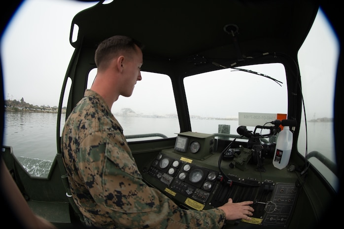 U.S. Marine Cpl. Braxton Shrader, a combat engineer with Bridge Company, 7th Engineer Service Battalion, 1st Marine Logistics Group checks the gauges of the Bridge Erection Boat (BEB) during the boat licensing course along the coast of Camp Pendleton, Calif., June 21, 2017. The BEB deploys improved ribbon bridges, which are long two-way platforms used to transport heavy equipment, such as tanks, over bodies of water. (U.S. Marine Corps photo by Lance Cpl. Timothy Shoemaker)