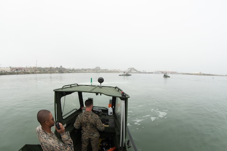 U.S. Marine Sgt. Lewis Kennedy, a combat engineer with Bridge Company, 7th Engineer Support Battalion, 1st Marine Logistics Group communicates over the radio aboard a Bridge Erection Boat (BEB) during the boat licensing course along the coast of Camp Pendleton, Calif., June 21, 2017. The BEB deploys improved ribbon bridges, which are long two-way platforms used to transport heavy equipment, such as tanks, over bodies of water. (U.S. Marine Corps photo by Lance Cpl. Timothy Shoemaker)