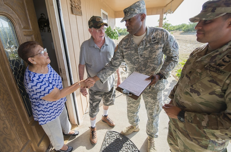Sgt. 1st Class Rhody Merisier, middle right, and Staff Sgt. Aldo Blanco, both assigned to the 478th Civil Affairs Battalion based in Miami, conduct a survey with residents of a colonia currently without potable water near Laredo, Texas, June 23, 2017. Nearly 200 Reserve Soldiers are participating in an Innovative Readiness Training mission to improve infrastructures in colonias along the Texas-Mexico border. (Photo by Sean Kimmons)