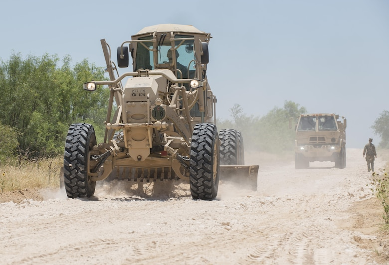 Soldiers with the 277th Engineer Company based in San Antonio repair a 2.5-mile stretch of dirt road in a colonia near Laredo, Texas, as part of an Innovative Readiness Training mission June 23, 2017. Nearly 200 Army Reserve Soldiers are participating in the mission along the Texas-Mexico border.  (Photo by Sean Kimmons)