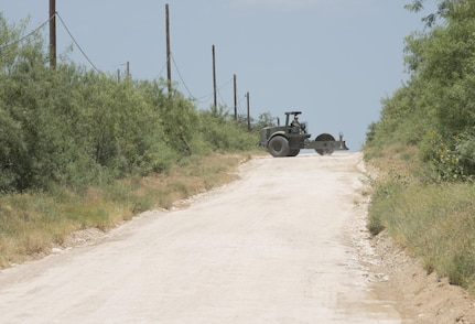 Soldiers with the 277th Engineer Company based in San Antonio repair a 2.5-mile stretch of dirt road in a colonia near Laredo, Texas, as part of an Innovative Readiness Training mission June 23, 2017. Nearly 200 Army Reserve Soldiers are participating in the mission along the Texas-Mexico border.