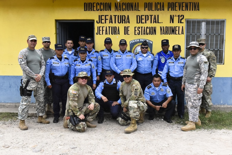 A team from Joint Security Forces and Honduran Police pose for a photo at La Paz, Honduras, June 20, 2017 after completing a Subject Matter Expert Exchange where they learned  techniques on how to tactically clear rooms to prevent casualties within their force.