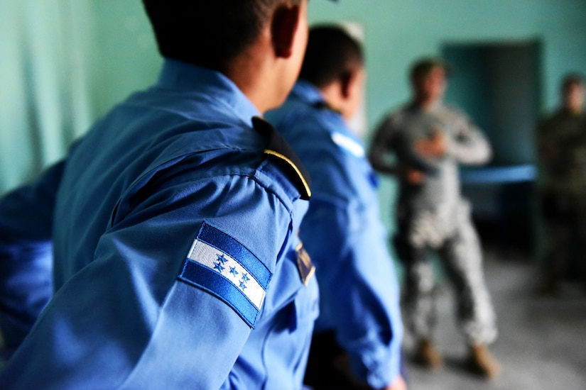 Honduran Police forces listen to a briefing from Joint Security Forces subject matter experts prior to practicing new acquired techniques on clearing rooms in La Paz, Honduras, June 20, 2017. Local police forces generally accompany JTF-Bravo exercises and work side by side with JSF to provide security during missions throughout Honduras.