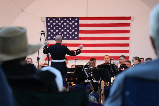 The 2nd Marine Division Band from Camp Lejeune, N.C., performs at Overman Park during the Sturgis Falls Celebration in Cedar Falls, Iowa, June 24, 2017. The band presence helps the recruiting efforts in the Midwest, including the Musician Enlisted Option Program. (U.S. Marine Corps photo by Sgt. Jennifer Webster/Released)