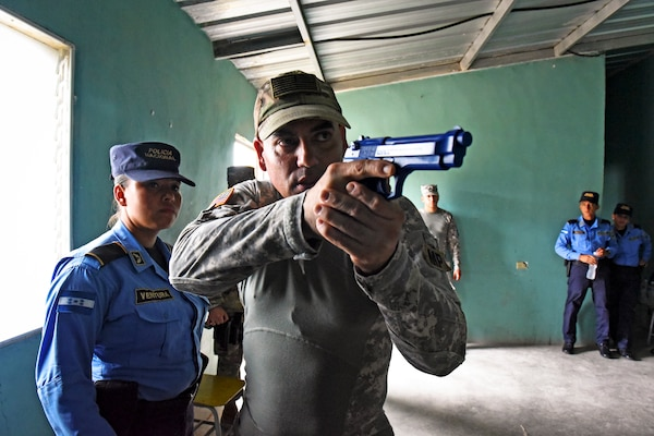 U.S. Army Sgt. Jesse Ruiz, Joint Task Force-Bravo Joint Security Forces explain tactical maneuvers to clear rooms to a team of local police officers at La Paz, Honduras, June 20, 2017.  Ruiz was the primary instructor during the Subject Matter Expert Exchange where the JSF members helped participants practice communicating with their team members using commands and coordination as they approached the target together.