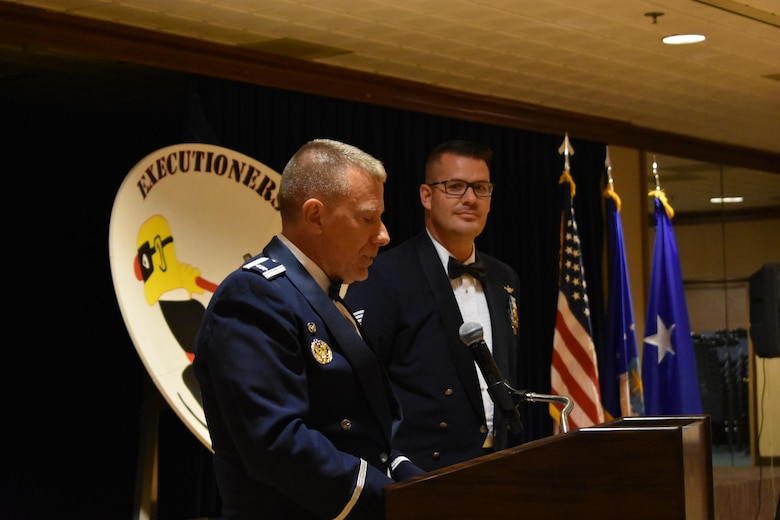 Lt. Col. Anthony Zilinsky, 25th Space Range Squadron commander, recognizes Tech. Sgt. Ryan Herter, 25 SRS operations flight chief, for his dedication to collecting the missing fragments of the squadron's history for the Centennial Dinner Banquet at Peterson Air Force Base, Colorado, Wednesday, June 21, 2017. Herter played a pivotal role in not only the history collection for the squadron's 100th anniversary, but also in the planning of the banquet itself. (U.S. Air Force photo/2nd Lt. Scarlett Rodriguez)