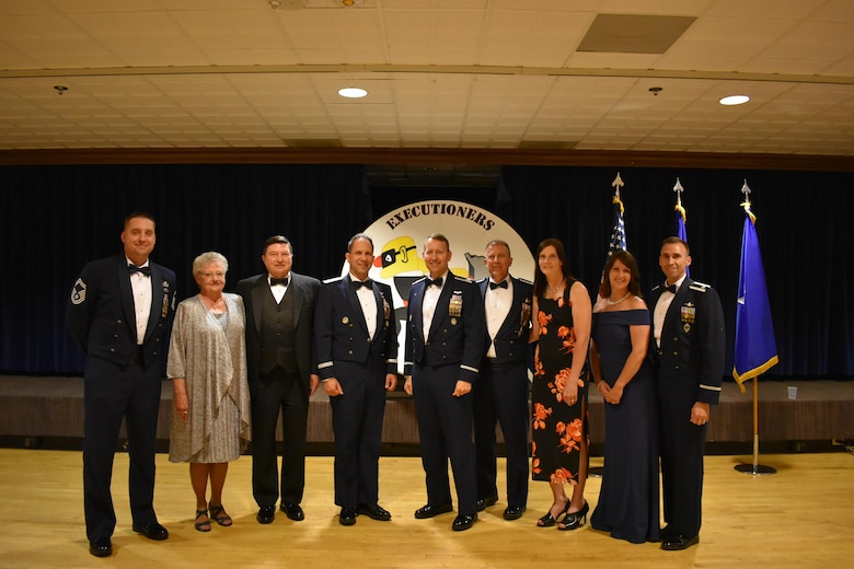 "25th Space Range Squadron past and present leadership gather with their spouses for a photo during the 25 SRS Centennial Dinner Banquet at Peterson Air Force Base, Colorado, Wednesday, June 21, 2017. The 25 SRS extended invitations to any and all ""Executioners"" to celebrate this momentous milestone. (U.S. Air Force photo/2nd Lt. Scarlett Rodriguez)"