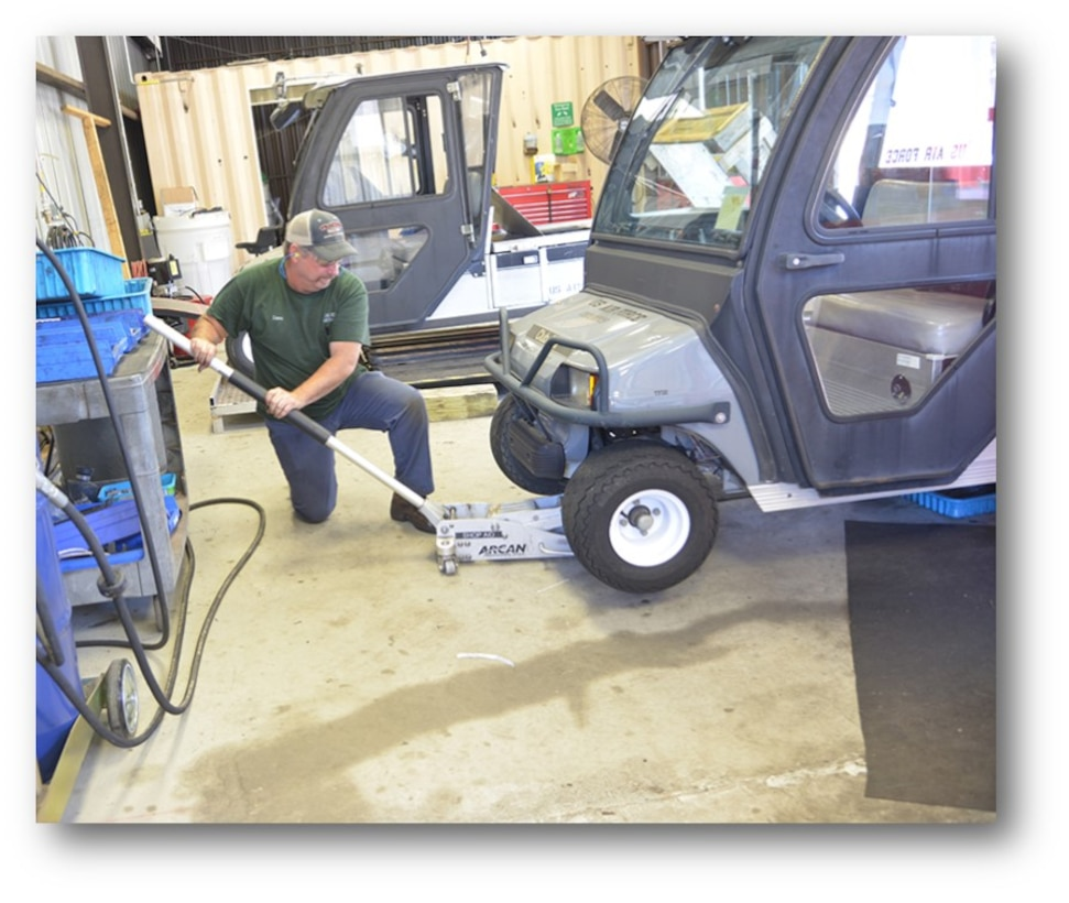David Barrentine, 402nd Maintenance Support Squadron mechanic, jacks up a golf cart for to perform mainte-nance on its wheel and tire assembly. Complex golf cart sustainment was previously accomplished by con-tract until the 402nd Maintenance Support Group took over the workload in March 2016. In just one year, the crew had not just kept up with demand for the vehicles; it had vastly improved every facet of the operation. (U.S. Air Force photo/RAYMOND CRAYTON, JR.)
