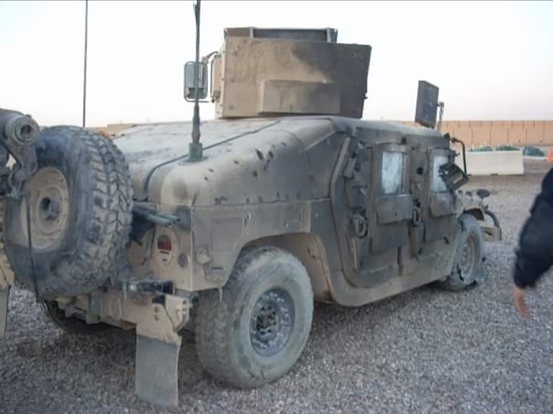 A Humvee is damaged and covered in burn marks after an improvised explosive device was detonated, also injuring then-Senior Airman Christopher D'Angelo, an 819th RED HORSE Squadron heavy equipment operator, Janu. 15, 2008. (Courtesy photo)