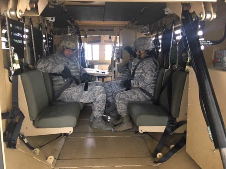 Class members from Emerge Moody sit in a Mine-Resistant Ambush Protected vehicle egress assistance trainer May 2, 2017, at Moody Air Force Base, Ga. Emerge Moody spent the day with the 820th BDG learning about the organization's mission and capabilities. (Courtesy Photo)
