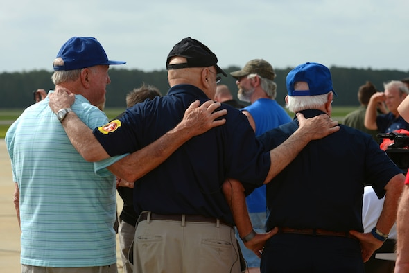 U.S. Air Force veterans gather during an F-16 Viper Demonstration Team practice at Shaw Air Force Base, S.C., June 23, 2017. The practice gave the veterans, former Wild Weasels, a close-up look at the F-16CM Fighting Falcon, the aircraft Shaw currently uses to carry out the suppression of enemy air defenses mission. (U.S. Air Force photo by Airman 1st Class Kathryn R.C. Reaves)