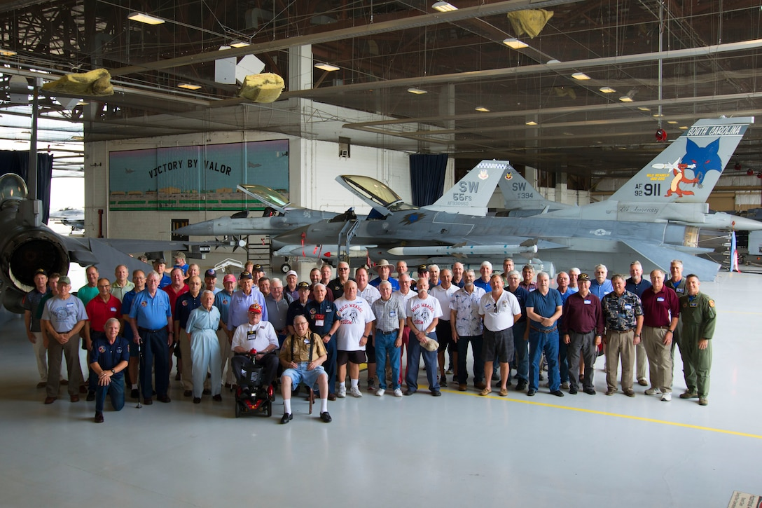 U.S. Air Force veterans gather for a group photo at Shaw Air Force Base, S.C., June 23, 2017. Approximately 60 former Wild Weasels attended a reunion at the base to celebrate the 52nd Wild Weasel anniversary, during which they recieved historical briefings, visited static displays and spoke with Airmen about the capabilities of Shaw's F-16CM Fighting Falcons. (U.S. Air Force photo by Airman 1st Class Kathryn R.C. Reaves)