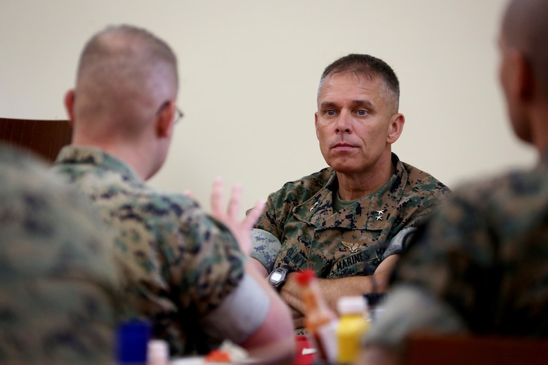 Staff Sgt. James Rader, left, asks a question to Maj. Gen. Matthew Glavy during a breakfast for 2nd Marine Aircraft Wing staff noncommissioned officers at Marine Corps Air Station Cherry Point, N.C., June 28, 2017. During the breakfast, Glavy set aside time to answer questions and open a dialogue between himself and the senior leaders under his command. Glavy is the commanding general for 2nd MAW and Rader is a tactical air defense controller with Marine Tactical Air Command Squadron 28, Marine Air Control Group 28, 2nd MAW. (U.S. Marine Corps photo by Cpl. Jason Jimenez/ Released)