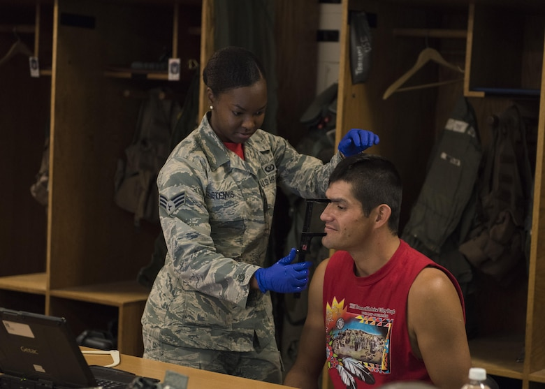 Senior Airman Kayla Stennis, 366th Operations Support Squadron aircrew flight equipment journeyman, fits Vice Chairman Buster Gibson of the Shoshone-Paiute Tribes of the Duck Valley Indian Reservation for a helmet, June 16, 2017, at Mountain Home Air Force Base, Idaho. Gibson needs the helmet to fit securely for his orientation flight, to ensure his safety. (U.S. Air Force photo by Airman 1st Class Alaysia Berry/Released)