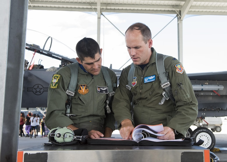 Col. Jefferson O'Donnell, 366th Fighter Wing commander, speaks with Vice Chairman Buster Gibson of the Shoshone-Paiute Tribes of the Duck Valley Indian Reservation before his orientation flight, June 16, 2017, at Mountain Home Air Force Base, Idaho. During the flight they flew all around the airspace. (U.S. Air Force photo by Airman 1st Class Alaysia Berry/Released)