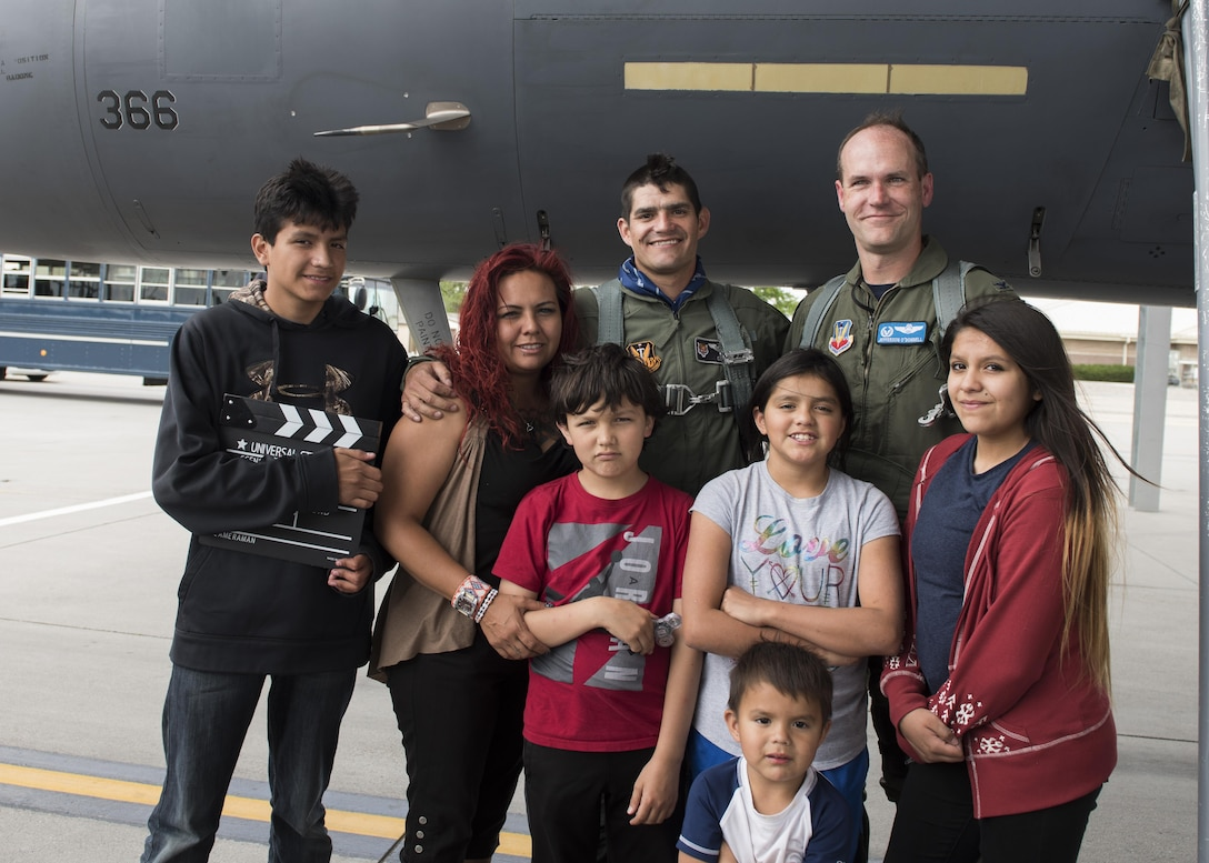 Vice Chairman Buster Gibson of the Shoshone-Paiute Tribes of the Duck Valley Indian Reservation and his family pose with Col. Jefferson O'Donnell, 366th Fighter Wing Commander, June 16, 2017, at Mountain Home Air Force Base, Idaho. Gibson's family was there to help motivate and encourage him as he went through the day. (U.S. Air Force photo by Airman 1st Class Alaysia Berry/Released)
