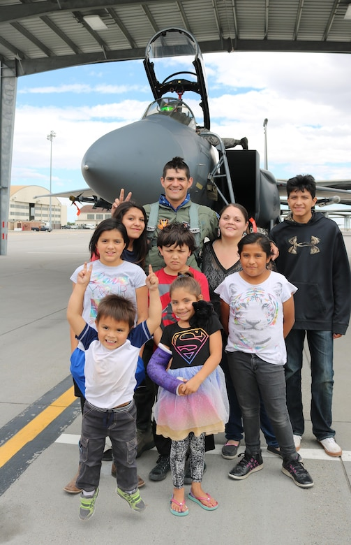 Vice Chairman Buster Gibson of the Shoshone-Paiute Tribes of the Duck Valley Reservation poses for a photo with his family at Mountain Home Air Force Base, Idaho, June 16, 2017. During the flight Gibson was able fly over the flightline and wave to the business council members and family. (U.S. Air Force Photo by Lt. Col. John Jacobus)