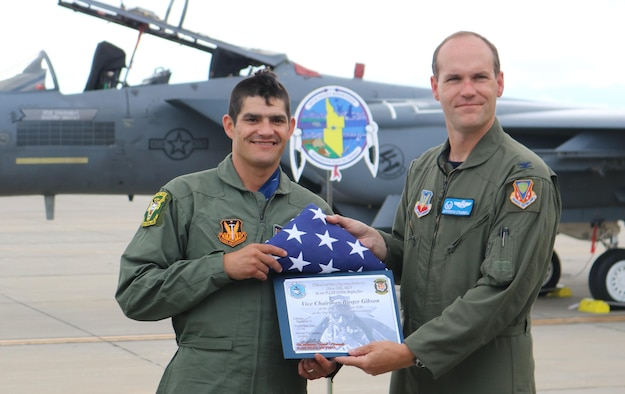 Col. Jefferson O'Donnell, 366th Fighter Wing commander, and Vice Chairman Buster Gibson of the Shoshone-Paiute Tribes of the Duck Valley Reservation pose for a photo at Mountain Home Air Force Base, Idaho, June 16, 2017. Gibson was presented with a flight certificate and a U.S. flag that was flown over the base. (U.S. Air Force photo by Lt. Col. John Jacobus)