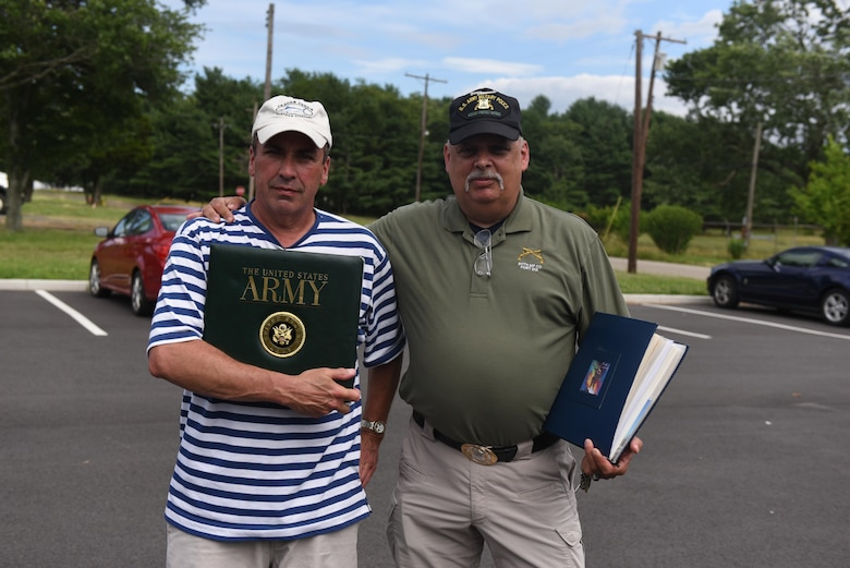 U.S. Army veterans display photo albums of their time at then Fort Dix in the 1970s at Joint Base McGuire-Dix-Lakehurst, New Jersey, June 23, 2017. The tour included a visit to the unit's old barracks and a trip onto the ranges the MPs used to train on.