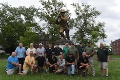 U.S. Army veterans from the 511th, 412th and 532nd Military Police Battalion visit the Fort Dix side of Joint base McGuire-Dix-Lakehurst for the first time in 40 years, June 23, 2017. The smaller cast ultimate weapon statue can be found outside of the Fort Dix-side headquarters building.