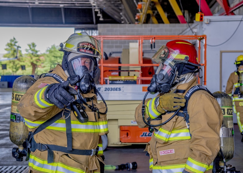 William Johnson, 375th Civil Engineer Squadron station cheif, discusses exercise procedures during a training exercise at Scott Air Force Base, Ill. on June 22, 2017. The exercise was part of the unit's Airport Rescue and Fire Fighting's training which tests their ability to arrive on scene, fight fires, and provide a rescue path as well as recover or rescue personnel. (U.S. Air Force photo by Airman 1st Class Daniel Garcia)