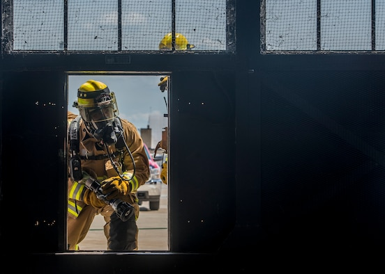 Members of the 375th Civil Engineer Squadron fire fighters perform an exercise at Scott Air Force Base, Ill. on June 22, 2017. The exercise was part of the unit's Airport Rescue and Fire Fighting's training which tests their ability to arrive on scene, fight fires, and provide a rescue path as well as recover or rescue personnel. (U.S. Air Force photo by Airman 1st Class Daniel Garcia)