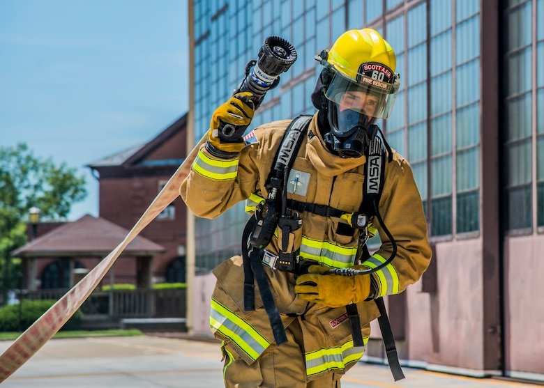 Airman 1st Class Jacob Childs, 375th Civil Engineer Squadron fire fighter, performs a hose drag during a training exercise at Scott Air Force Base, Ill. on June 22, 2017. The exercise was part of the unit's Airport Rescue and Fire Fighting's training which tests their ability to arrive on scene, fight fires, and provide a rescue path as well as recover or rescue personnel. (U.S. Air Force photo by Airman 1st Class Daniel Garcia)