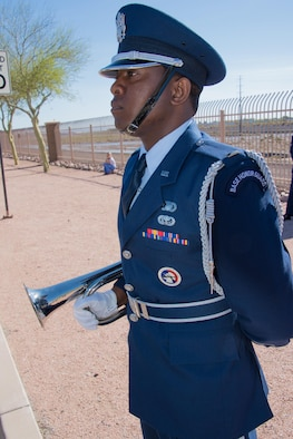 U.S. Air Force 2nd Lt. Tinashe Machona, assigned to the 161st Air Refueling Wing, stands at attention in a color guard detail before playing taps on his trumpet during Copper 5, an air crew memorial ceremony, at Goldwater Air National Base, Phoenix Ariz., March 13, 2017. Machona was the recipient of the 2016 Maj. Gen. Donald L. Owens Junior Officer of the year award at the wing. (U.S. Air National Guard photo by Staff Sgt. Wesley Parrell)