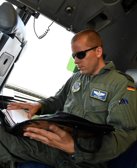 German air force Maj. Rico Persy, 14th Airlift Squadron pilot, reviews his pre-flight inspection checklist on-board a C-17 Globemaster III here June 26, 2017. Persy has been stationed at Joint Base Charleston since 2014 as part of the foreign pilot exchange program. Persy's home station is Wunstorf Air Base, Germany, home of the Air Transport Wing 62.