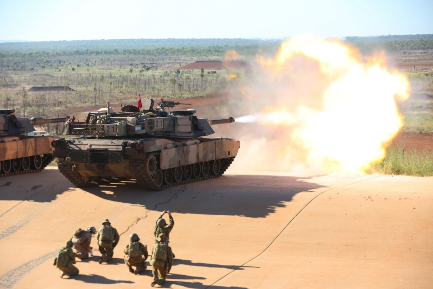 U.S. Marine Lance Cpl. Fernando Griego, gunner, Company K, 3rd Battalion, 4th Marine Regiment, 1st Marine Division, Marine Rotational Force Darwin, remotely fires an M1A1 Abrams with B Squadron 1st Armoured Regiment of the Royal Australian Armoured Corps, May 6, 2017. Marines remotely test fired the Abrams as a precaution after Australian Army soldiers had replaced the barrel ensuring its mission readiness.