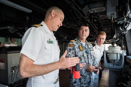 Capt. Nate Moyer, commanding officer of the amphibious transport dock USS Green Bay (LPD 20), and Cmdr. Peter Mellick, from the Royal Australian Navy, discuss ship maneuvers during a sea and anchor detail. Green Bay, part of the Bonhomme Richard Expeditionary Strike Group, is operating in the Indo-Asia-Pacific region to enhance partnerships and be a ready-response force for any type of contingency, June 28, 2017.
