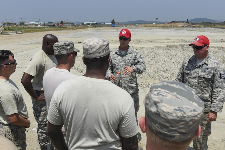 U.S. Air Force Tech. Sgt. Todd Alter, 554th Red Horse Squadron pavements and equipment contingency training NCO in charge, speaks with members of the 8th Civil Engineering Squadron June 23, 2017, Kunsan Air Base, Republic of Korea. The 8th Civil Engineering Squadron participated in airfield damage repair training as part of the final Exercise Silver Flag training held at Kunsan. U.S. Air Forces Pacific will now focus on ensuring Airmen have their three-year Silver Flag currency, prior to arriving on the Korean Peninsula, instead of conducting the training here. (U.S. Air Force photo by Senior Airman Michael Hunsaker/Released)
