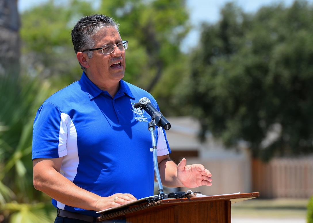 San Felipe Del Rio Consolidated Independent School District Superintendent, Dr. Carlos Rios addresses the community during the ground-breaking ceremony at Laughlin Air Force Base, Tx., June 23, 2017. In an effort to unite the community, this school will be open to both military families and families within the community.